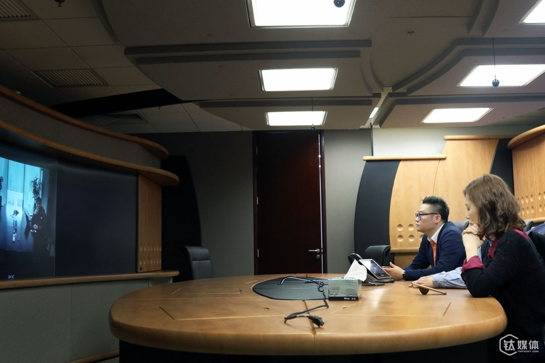 In a video conference hall of an investment firm, Ms. Li was holding a video conference between a representative of the firm and two co-founders of a startup team. The representative was willing to invest 30 million RMB in the startup, but wanted to discuss further with the two co-founders over the estimated market value of the project.