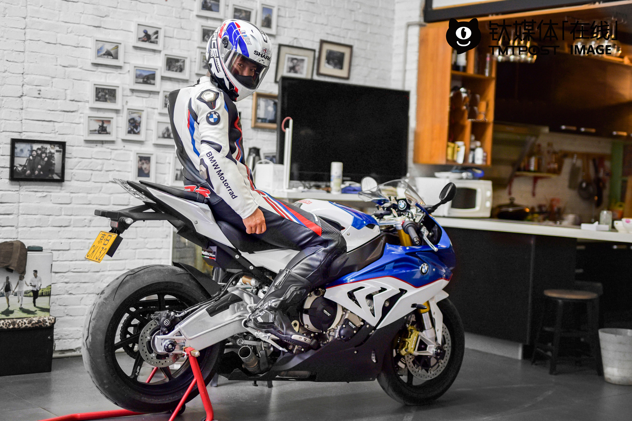"""He had two motorcycles, and both of them are worthy over 300,000 yuan (over $ 45,229). """"I also have a car, but when I really want to feel the wind, speed, I ride motorcycles. In leisure time, I also design and modify motorcycles. Besides, I am also a super fan of photography, but riding motorcycles is my lifetime hobby,"""" he told TMTpost."""