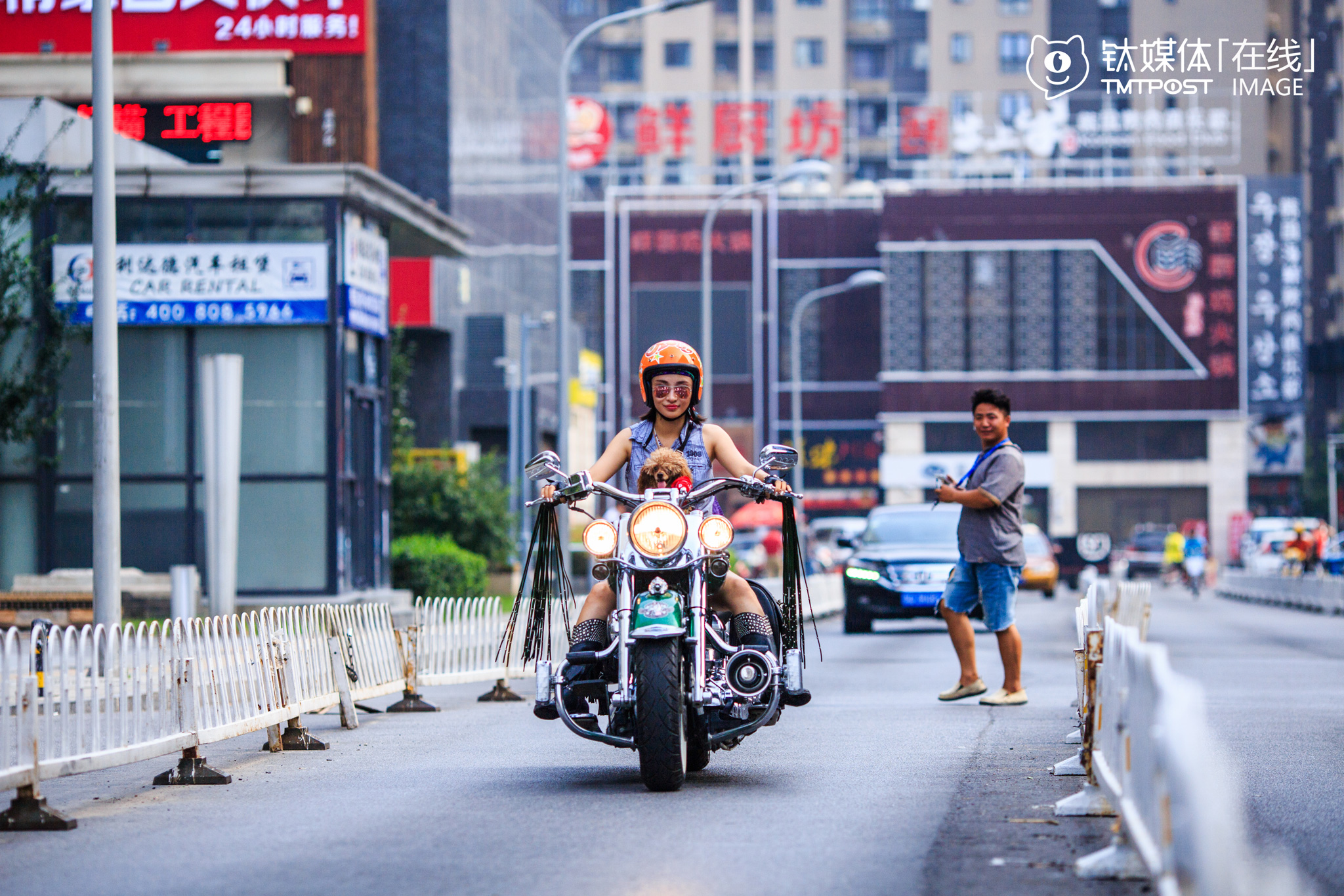 "Yan Han, owner of an interior design studio, is also founder of female Harley motorcycle riders club ""Top Riders"". She loves Harley motorcycles and bought her first Harley (Harley 883L) four years ago at the price of 300,000 yuan. Her second Harley is modified Softtail Deluxe and cost her 500,000 yuan. ""It's the dream of every motorcycle rider to have a Harley. Different from ordinary motorcycles, Harley represents the pursuit for freedom and happiness instead of pure speed. I travelled on Harley for at least 20,000 kilometers every year,"" she said."
