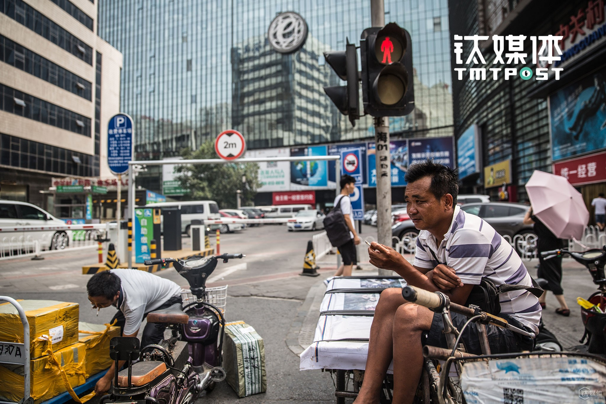 "Mr. Wang had already been carrying goods around Zhongguan Village for around a decade. ""There used to be over 30 handcart driver like me around these electronics malls, but over half of them have already left for somewhere else,"" he told TMTpost."