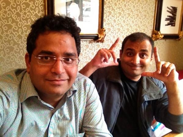 Paytm的创始人夏尔马(左)和Paytm支付银行CEO 塔哈尔(右)