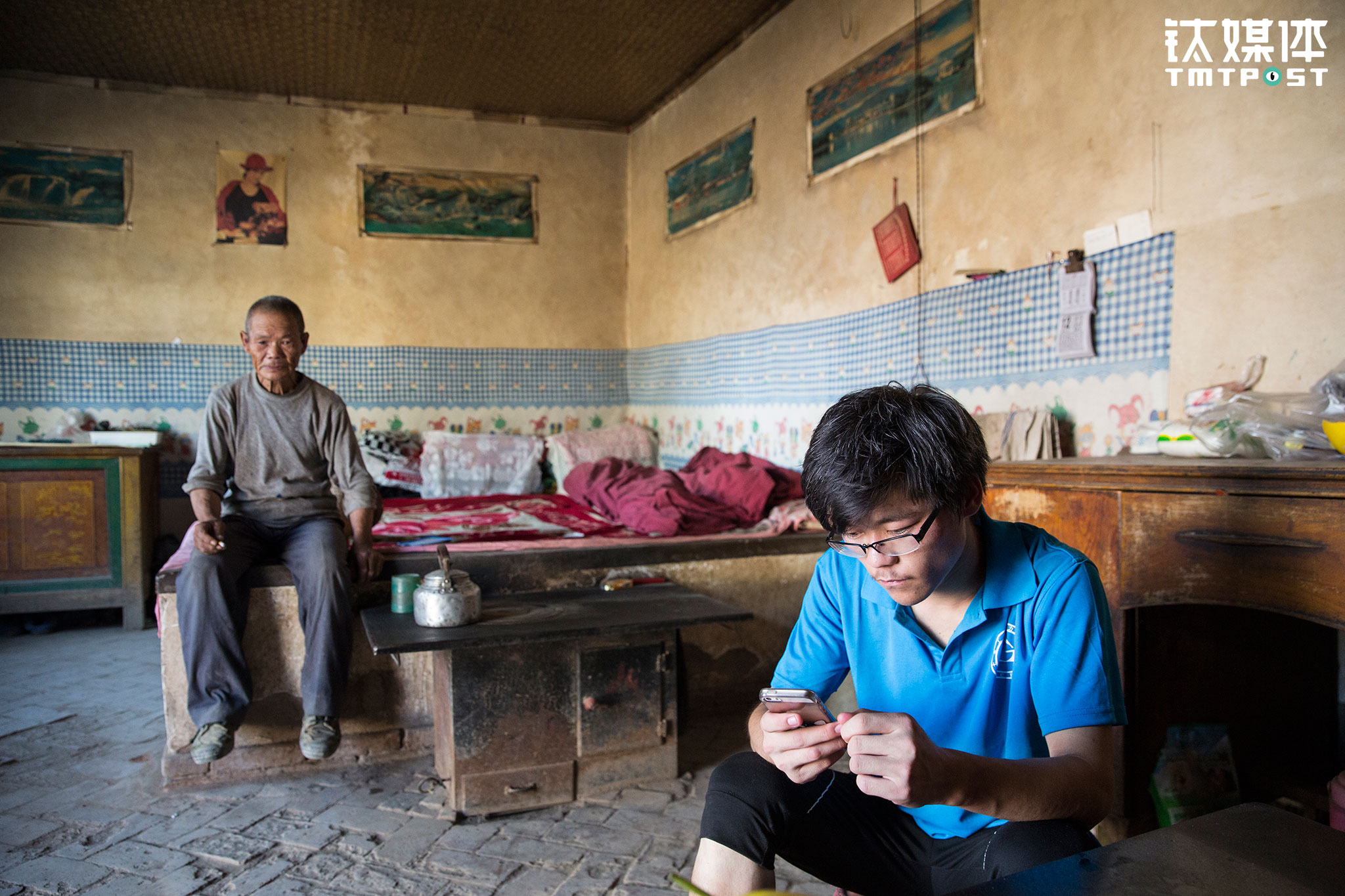 "The father and son live in these three shed bungalows. As a matter of fact, these simple shelters are not theirs. ""A few years ago my house just couldn't hold and collapsed. My uncle's family moved to Inner-Mongolia and left this yard. So we moved in here,"" Li said. In this underprivileged household, the illiteral father always tells his sons that studying will change their fate. For Li Sheng, his goal is get his father out of the field and provide him with proper meals every day."