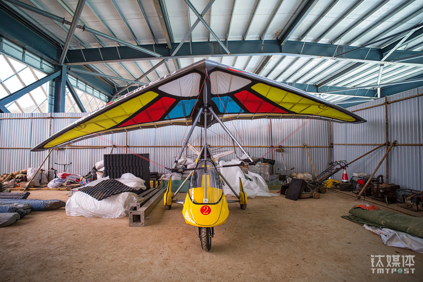 A powered paraglider in the temporary hangar. This paraglider can reach a cruising speed of 100km/h and it's mainly used for aviation training, touristic use, aerial photography, and forest protection etc. Its lowest flying height can be as low as one meter while the highest can be 5,000 meters.