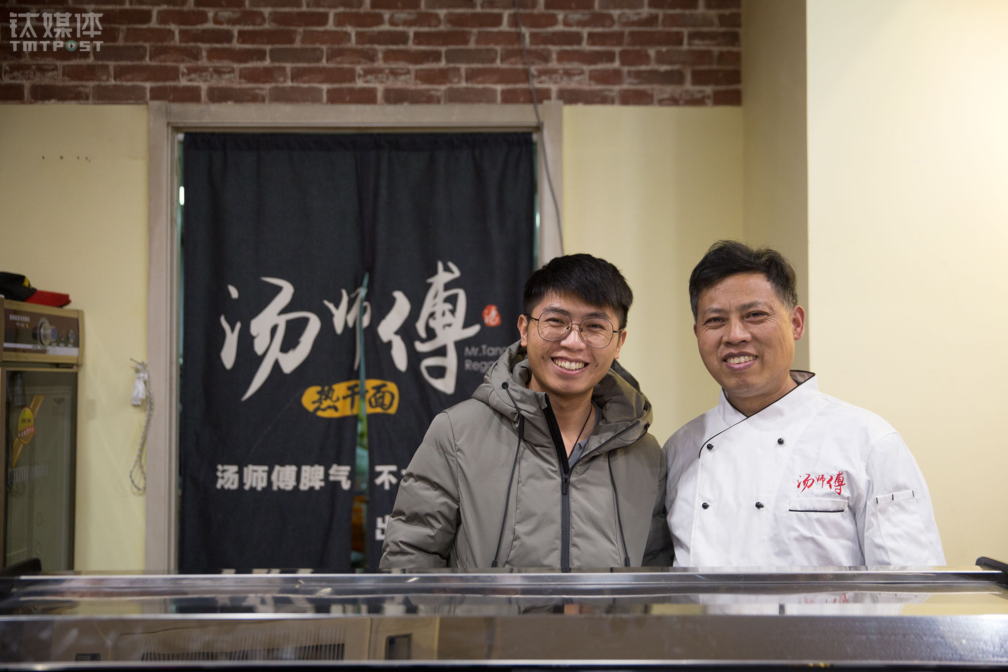 Changyingtianjie Business Street, Beijing, December 27th, 2017. Tang Huai and his father were busy at their restaurant Master Tang's Hot Dry Noodles. This is the fourth branch of Master Tang's. Tang Huai was a former programmer at an Internet company while Tang is a life-long noodle maker. Prior to coming to Beijing, Tang's father had been selling noodles in Wuhan for years.