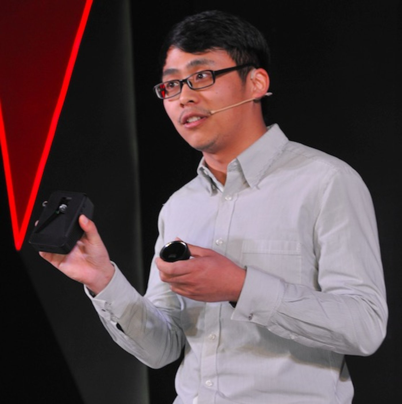 MINIEYE's founder Liu Guoqing showing his products