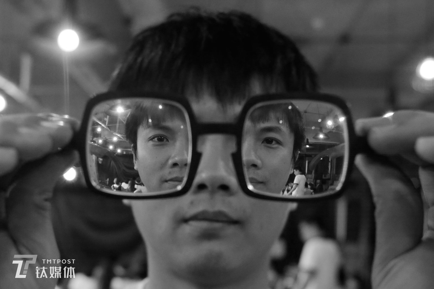 """September 18, Beijing, stand up comedian Xiao Kuai poses for """"Online"""", the video journalism program of TMTPost, while holding his glasses."""