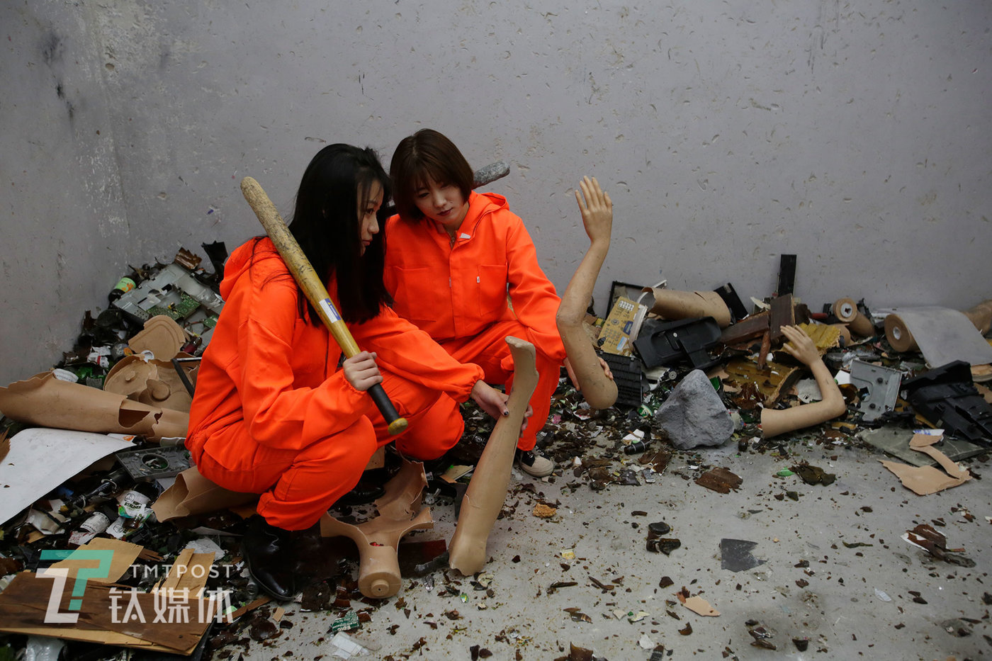 Two female customers are having their photo taken in the rage room. Soon after its opening, the rage room has become an attraction for internet blogebrities to tick their bucket lists. Many customers come to experience the rage room after seeing online short clips about it.