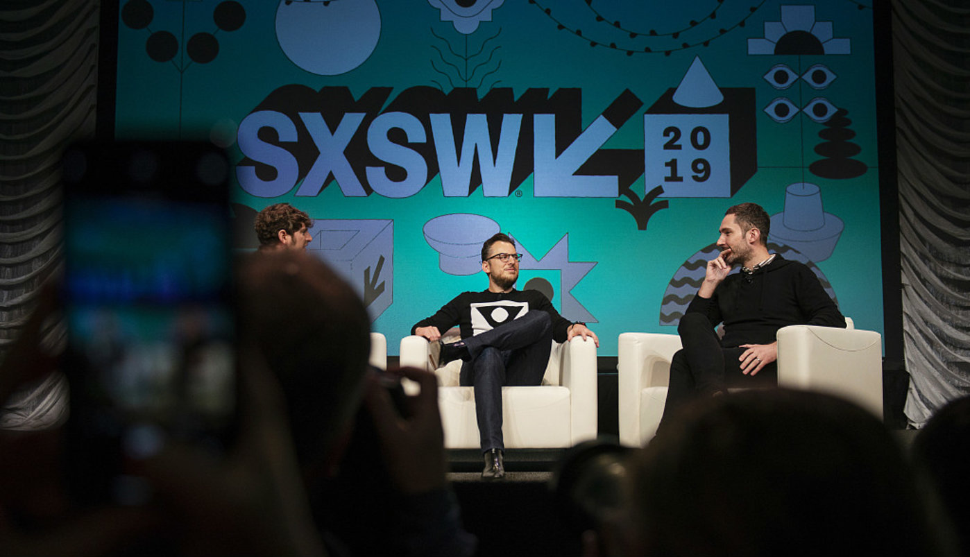 Mike Krieger, center, and Kevin Systrom, co-founders of Instagram