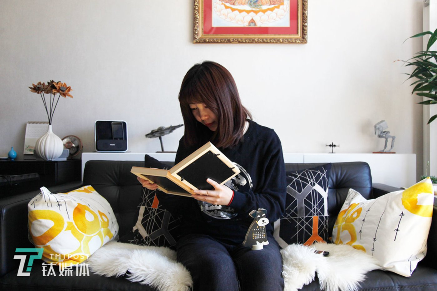 March 23, Fengtai, Beijing. Bei Bei (a pseudonym) looks at photos of her beloved pet dog Nari.