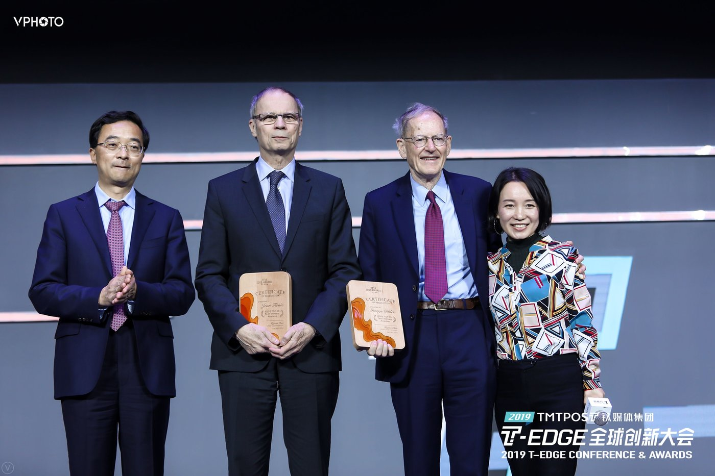 Head of Beijing's Daxing District Wang Youguo (left), Nobel laureate Jean Tirole, economist George Gilder and TMTPOST Group founder and CEO Zhao Hejuan at the T-EDGE Awards