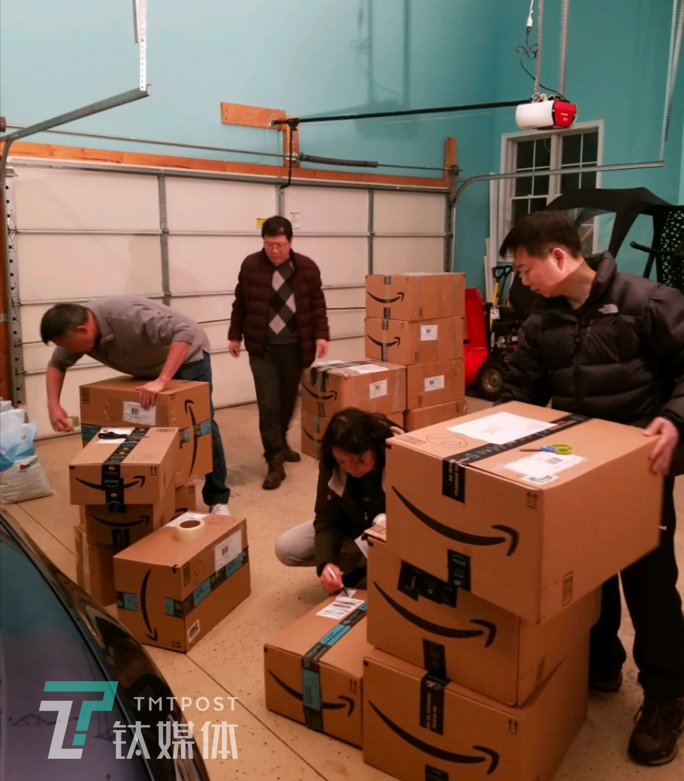 Volunteers from the Orange County Chinese Association pack 60 cases of medical masks to be sent to Wuhan. (Woodbury, N.Y. State, U.S.A., February 6, 2020)