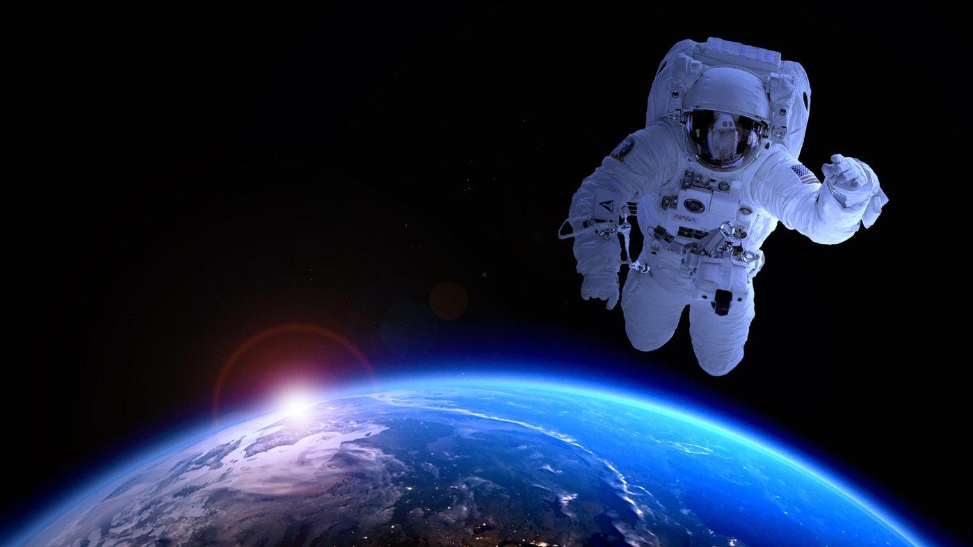 (图片来源:无版权图库Jooinn/https://jooinn.com/images/astronaut-in-space-69)