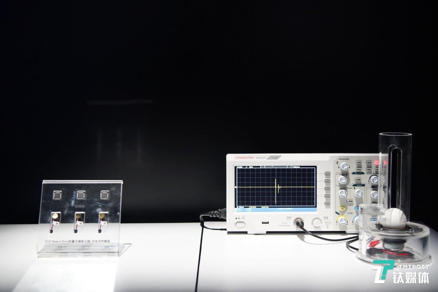 通过压电式声学方式将振动波转化为电信号